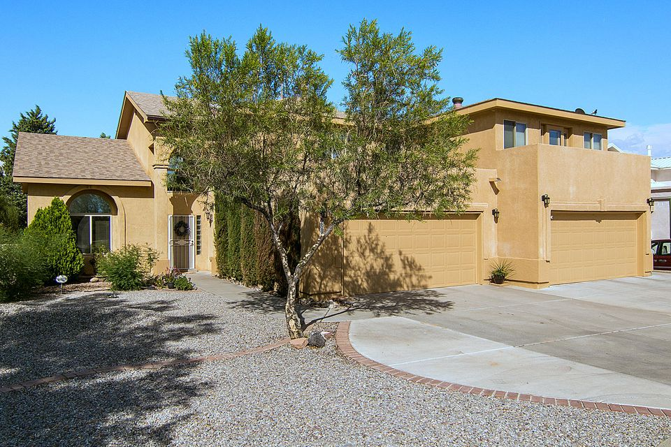 4 car garage w/ refrig air & an Guest House/AirBNB/in-law quarters. No HOA, views to the Sandia's & petroglyphs, Updated kitchen w/ 2018 appliances, GE Slate Refrigerator, Dishwasher, 6 Burner Range, & Microwave. Granite counters, stainless steel sink, pantry & breakfast nook. Soaring ceilings & cozy fireplace, Large .30 ac lot w/ back yard access poss, 17X15 covered patio & open patio as well. Storage shed stays & play ground if needed. Updated windows thru out, Hunter Ceiling fans, Smart home wiring package, USB outlets, motion lights in garage, pre wired for Festive Lighting. Smart thermostat is programmable & includes an app for your phone. Updated 2018 Master suite w/ separate shower and tub, walkin closet, double sinks & filtered water at sink.