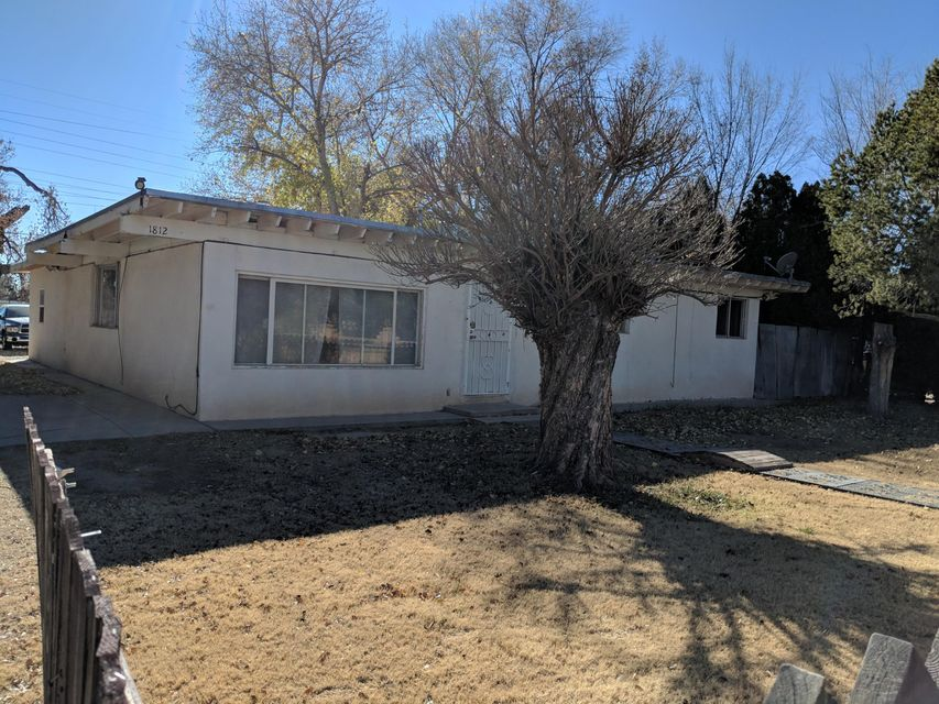 Home is situated on a quiet street that is near Parks, Schools, Shopping and Dining. It has 3 pleasant sized Bedrooms, Living Room, Large Den, Country Kitchen with Breakfast Nook.  Large Fenced Yard has Backyard access. Don't miss out on this cute home in an amazing location.