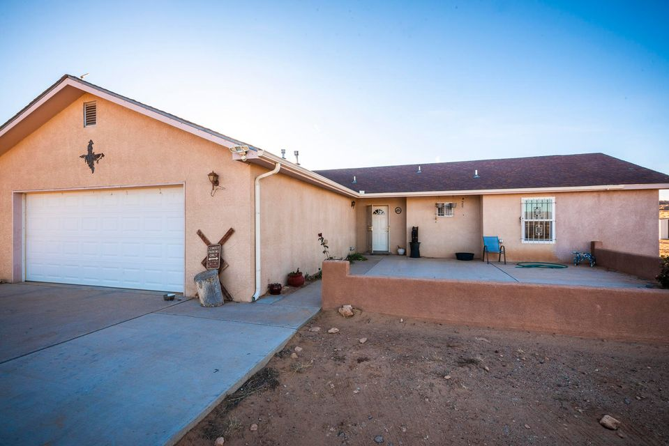 Welcome Home!! This charming home in situated on a large lot with gorgeous VIEWS and room for horses!! Nice and open floor plan with spacious bedrooms!! Refrigerated Air!! New roof to be installed mid December!!  Easy and close to freeway access!! Call to view this home today!!
