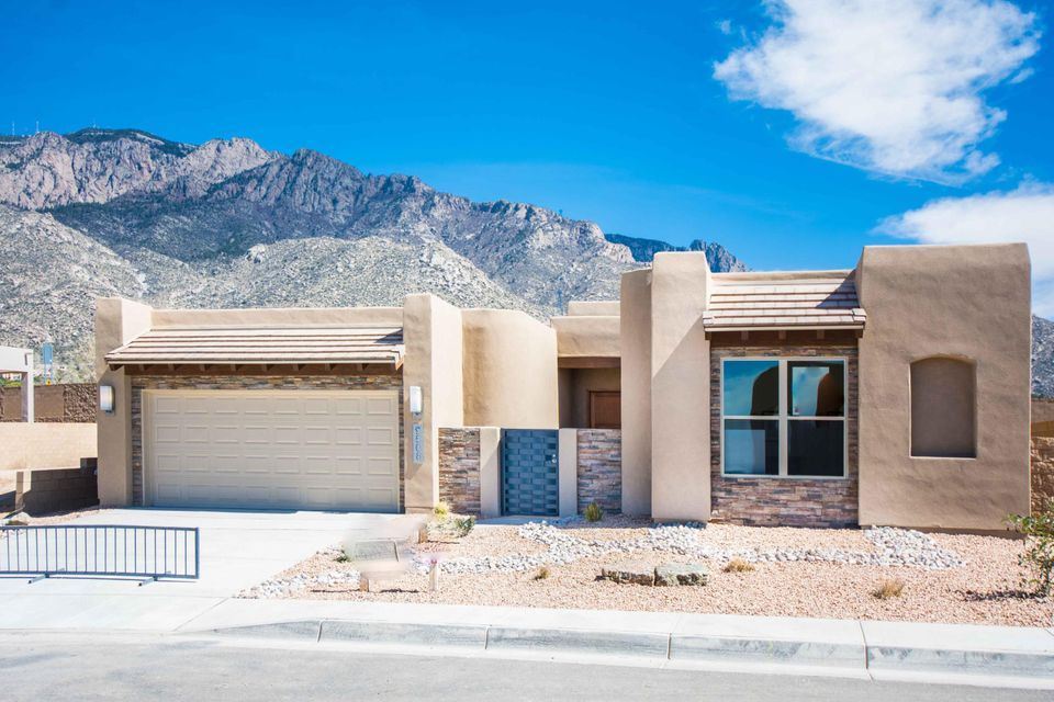 New construction this Scott Patrick Custom home has spectacular views of the Sandia Mountains.  Some of the home features include walk in Butler pantry, kitchen Island, granite countertops, stainless steel appliances, front yard landscaping including sprinkler system with timer, garage automatic openers with one keypad and much more.  Mandatory HOA fees to North Tramway Homeowners Association in the amount of 25.00 per month.  Additional HOA fee to Sandia Heights Homeowners Association with an additional 8.00 per month.