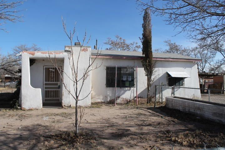 This 3 bedroom house has 1.5 bathrooms.  The living room has a cozy fireplace with insert.  The dining area is off the kitchen.  Laundry area in storage/shop.  Security bars.  Detached 2-car carport.  Large fenced lot is .30 acre.