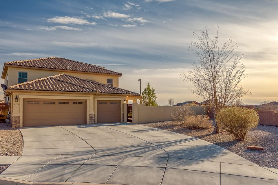 Semi Custom Artistic Home Leed Certifiedsitting on Large Lot in Cabezon area!  Homeis across from park, with a Gazebo andviews of the Sandia's and Sunsets!!! 2 MasterSuites, 2 Living Areas, Custom Kitchen & Cabinets with Solid Surface Counter Tops.Open Floor Plan,  Great for Multi-Family or In-Law Quarters.  Gold Leed Certified at 79, Solar Panels, 3-Car Garage , Security Cameras.  Sits on end of Cul-De -Sac, Fully Landscaped and Priced to Sell!  Electric Bill approx. $15.06 per month and Gas Bill approx.  $31.00 per month.