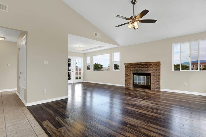 Vaulted Ceiling and Wood Burning Fireplace add to the drama of this open floor plan.