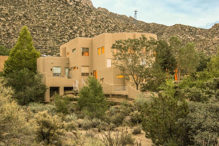 Home nestled in Sandia Mtns