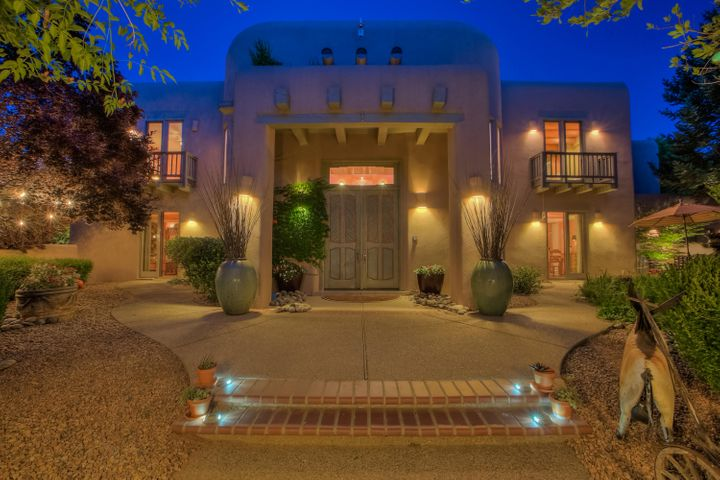 Grand entry to custom 6600 square- foot masterpiece in desirable North Valley Tinnin Farms