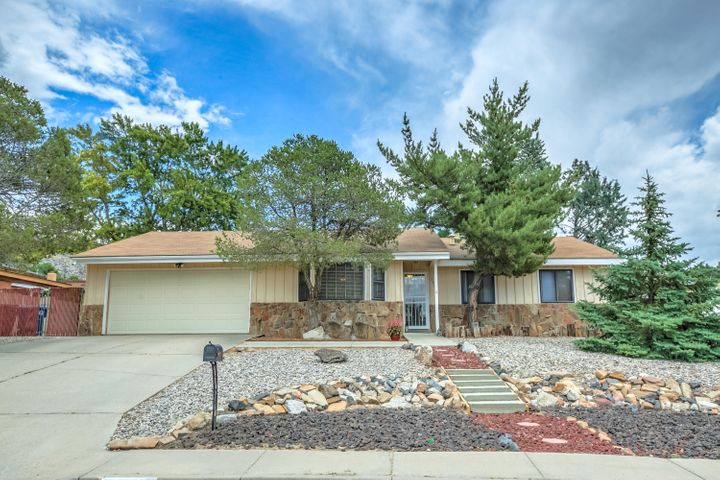 Northeast Heights 3 bedroom, 2 car garage beauty located on a large lot with side yard access~