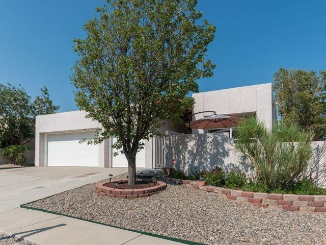 Contemporary home with 3 car garage and private gated courtyard