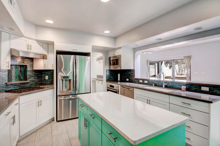 Chef's Kitchen with Island, Top Notch Appliances, & Beautiful Counters