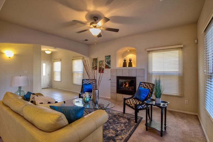 Downstairs entry and Living room with gas fireplace