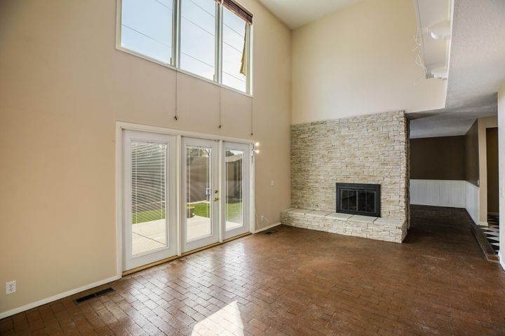 Brick floors, fireplace and access to east facing rear yard