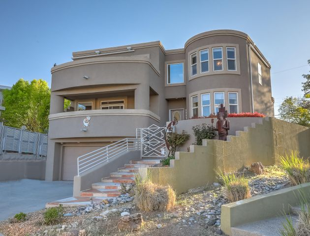 WELCOME TO 4000 GRACIA CT NE! (Please note: the statuary does not convey.)