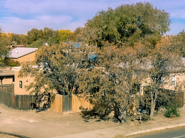 Welcome to 3619 Rio Grande Bl NW, two houses on a .41 AC lot in the heart of the Near North Valley!