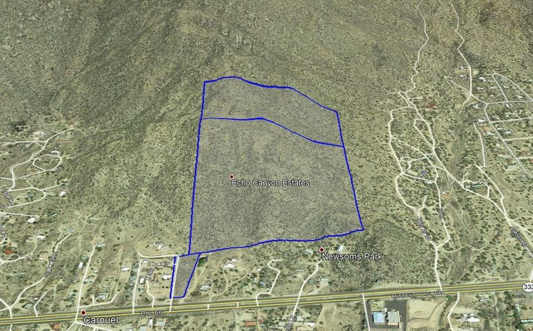 A rare opportunity near Albuquerque... own 61 Acres of the Sandia's and backing to the National Forest on two sides. A private paradise with amazing rock formations, meadows, and views like nothing else. This property consists of three parcels with access off RT-66 in Carnuel, 3 Minutes from Tramway and I-40.