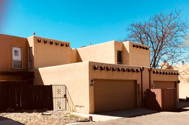 Welcome to you new townhome in Villa Encantada.  . Three bedrooms and 2.5 bathrooms await you as you enter thru the gated front yard. The entry leads to the living/dining room with wood burning fireplace and sliding glass doors to the back yard. The kitchen has room for a breakfast area and leads to the service room with  stacked washer and dryer and garage access. Up the stairs to the three bedrooms and two baths. Villa Encantada offers residents a pool and community rooms.  Arroyo del Oso Golf  Course is near by and so are shopping and dining  places. Seller holds an active Arizona Real Estate License.