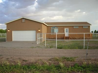 Here is your affordable horse property in the greenbelt!!  Lovely Karsten Modular (true modular) with full pipe fencing/xfencing, 2 stall loafing shed/barn, attached garage, entry deck. Bucolic views, ditch access for riding and watering your pasture.