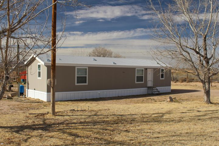 Come out to the country! Room to roam on this approximately 2 acre parcel. Has a nice single wide, 2BR/2BA manufactured home built in 2017, almost brand new!This property features an acre of irrigated agricultural land, water rights convey. Appliances include refrigerator, gas stove,  washer and dryer.