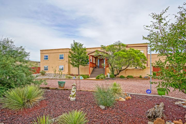 Assumable loan! Gorgeous custom home in Tome Valley is ready for it's new owners! New GRANITE COUNTERTOPS in kitchen!! Cozy master bedroom downstairs & has updated Master bath w California his & her closets. The grand eat-in kitchen features lots of windows & overlooks the living room where you can relax & enjoy the gorgeous sunset from oversized windows. Home has 24 Solar Panels (owned) & 2 refrigerated combo units which keeps your utility bills to a minimum! Flex-space on the lower level can be an office, bedroom or man-cave! RV & Car Lovers - come feast your eyes on the 1226 sq ft RV shop with a Bendpak auto lift, 2 bays and RV Sewer hookup! Casita in the back can be updated to be a mother-in-law quarters, guest house and MORE!