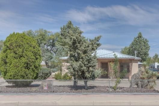 This unique valley property is adobe construction and has lots of original hardwood flooring.  Situated on a 3rd of an acre with ditch rights!  Seller has lovingly cared for property so it's in good condition for its' age.  Original home is 2148 sf and has had some updates over the years.  Guest / In-Law Quarters - included in the sf has it's own entrance, bath, and kitchen!   Giant work shop - over 1000 sf - can be used for multiple purposes: Business, Artist's Studio, Yoga, Dance, Rec Room, additional living area, you name it!  There's also a smaller shop of 320 sf in the back that has power, heat, cooling, and water!.  Circular drive makes it easy to get in and out.  Close to schools, shopping, and entertainment.