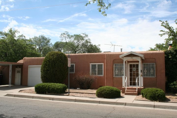 Gleaming hardwood floors, wood framed windows, interior fairly sparkles!  Newly installed roof!  Just a stone's throw from UNM and Knob Hill. Private backyard with storage.  Bonus bath combined with service room.  Lightly lived in for the past 50 years+.  Yard could use some imagination, but other then that this home is ready for your buyer!