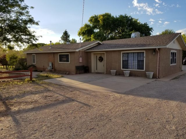 Escape the city madness to this CUSTOM horse property gem. located in the heart of rural New Mexico, this property gives a whole new meaning to enjoying the peace and beauty of nature. Complete with a 2 car carport AND 2 car garage as well as a finished 8x10 work space.  3 bed, 2 bath situated on a rare 1 acre lot for the area. Private landscaped backyard with lighted Pergola surrounded by mature trees makes everyday feel like a relaxing getaway vacation. Not to mention it makes for an envious entertainment location any time of year.