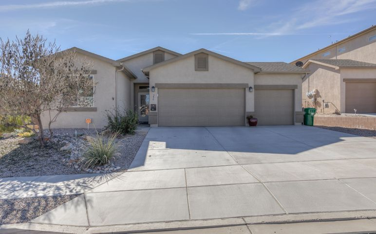 Welcome Home to this beautiful 3 bed 2 bath & 3 car garage located in Rio Rancho. This home offers all newly updated counters and flooring throughout the home ready to move in. The backyard is well maintained including a great shade structure, fully landscaped and gorgeous views of the Sandias; making this a great place to have your morning coffee or easy entertaining for the family. This home is a certified Green house offering great savings with Solar attached.
