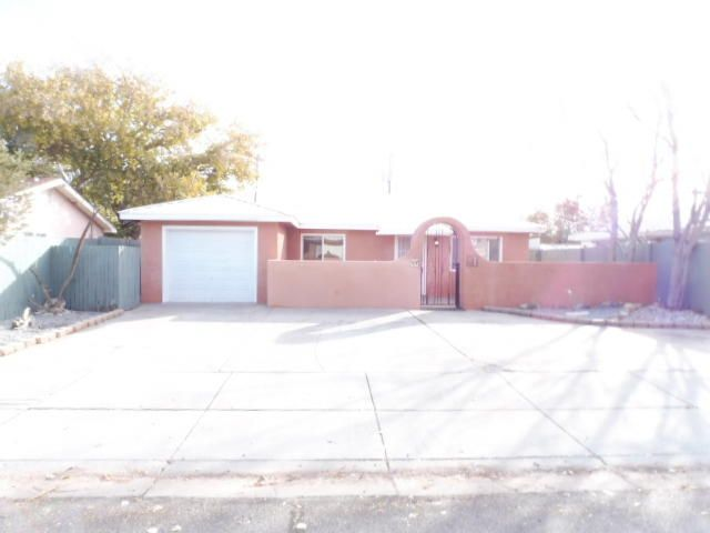 Spacious two bdrm., 2 bath in the Heart Of Los Lunas. Step in to a huge living area with cozy fireplace. Nice spacious kitchen and dining area. Huge Master Suite, with walk-in closet. Bonus rm. attached to master suite would  be great for an office, gym, game rm. or den. Nice open patio area in back yard, and large shed.  Beautiful front yard courtyard patio.