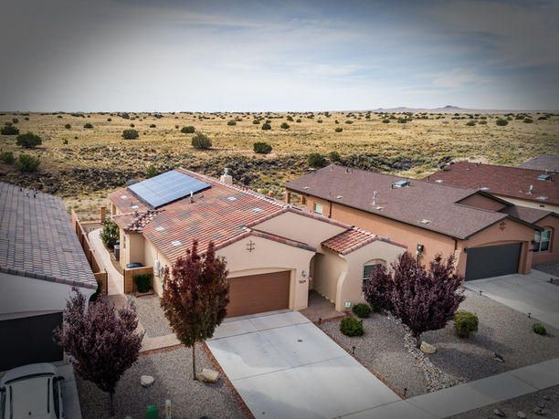 A Custom Abrazo Smart home, Silver Cert, backyard abuts the Petroglyphs, with gate access. Views of the Abq skyline, hiking, hot air balloons......nature. 1702 sf, 3BR, 2 full baths, an en suite spa to the Master w/jacuzzi bath, stand-alone shower, heated floor, far infrared sauna and walk in closet. Built in 2013, extra wide entrance, skylights, cust open fl plan, 12 ft ceiling, tile and Pergo flrs. Enlarged patio doors. Surround sound, gas FP w/blower, Quartz counters, stainless steel stove, micro, d/w, fridge stay! W/D and freezer, stay also! Solar panels, AC, tankless WH, 2 veh. garage, storage, insulated and finished. TAEXX pest system. Relax in the beautiful 6-person hot tub and enjoy peacefulness.  NO HOA!