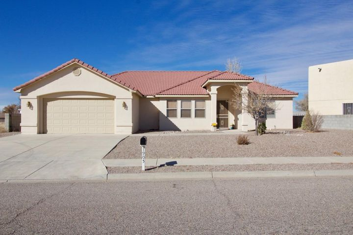 This GORGEOUS 3 bedroom home with refrigerated AC is ready for a new owner looking for quality craftsmanship in the Rio Communities golf neighborhood! The spacious and open living room, dining room, kitchen, and breakfast nook all have beautiful tile floors. It was built in 2007 and has over 2700 SqFt of living space plus a 2 car finished garage with a large storage room attached. The backyard opens up to one of the golf course greens and has an 80 SqFt storage shed/workshop with electricity.  Enjoy the beautiful sunsets from the covered patio. All appliances stay.
