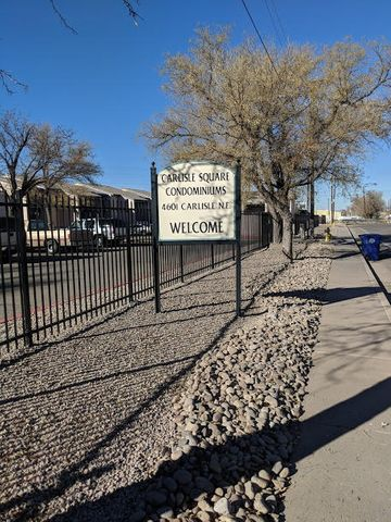 Worth Seeing! Worth Owning! Nearby shopping, entertainment, and restaurants. Convenient freeway access and bus line to UNM. Large Master with walk in closet. Lots of storage. Bright and light with tile flooring and carpet in bedrooms and living area. Community playground, BBQ grill, laundry facility, and recreational room. This is a must see!