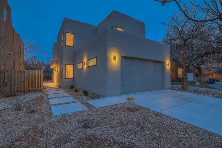 *RARE* Contemporary Open concept New construction home in highly desirable Rio Grande Compound!Steps way from Rio Grande paved trails and Rio Grande Nature State Park. Home has 2 Masters (One Upstairs and one Downstairs) and also Two Laundry Rooms(One Upstairs and One Downstairs.) Huge Waterfall Granite Island, Zero Clearance Fireplace, view to Rio Grande Nature Center and so much more. Home has hardwood beautiful Tobacco Acacia hardwood floors throughout its custom tile on wet areas. Home boasts too many phenomenal features and is truly must see and won't last long. We'll let the pictures do the talking! :0)