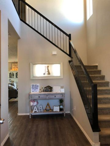 This unique floorplan is the only one in this subdivision with this much square footage. The open kitchen, dining & living area have lots of windows to bring in the natural light & is a great entertaining space; which continues onto the patio w/ a water feature, grass, sprinkler & drip system. Many upgrades such as the beautiful, railed staircase & laminate wood look flooring, that flows throughout the downstairs. Powder bath downstairs. 2 large closets & pantry provide extra storage. 4 bed/2 full baths, laundry room, & large loft upstairs.  PAID Solar panels provide for low energy bills. All Stainless Steel kitchen appliances & W/D included in the sale. Home sits on an oversized lot with plenty of room in the back yard for BBQ's, Entertaining & watching the sunset. Volcano Vista Dist.