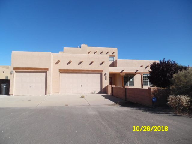 Pueblo Style 2 story home with Unobstructed Mountain Views.  Family home has large kitchen w/stainless steel appliances, island, and pantry.  Master suite is downstairs with large walk in closet, spacious bath and access to back patio.  Upstairs den with fireplace, wet bar, 1 bedroom plus bath. Large 3 car garage with extra storage.  Large back patio, plus balcony with beautiful views.   Additional back yard space perfect for swimming pool or recreation court.  Quiet neighborhood.