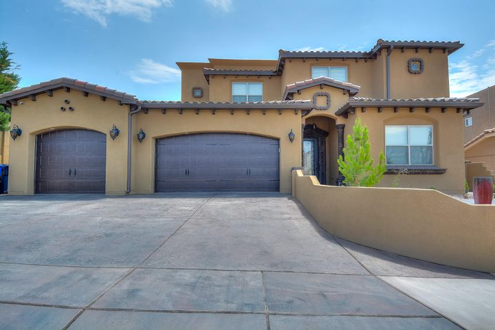 Quality is in every detail of this stunning custom build by Mario Perez. Featuring 3,767 sf with 5 bedrooms, 4 bathrooms, a loft and 3 car garage! Travertine flooring throughout the 1st floor main living areas! Incredible gourmet kitchen with high-end cabinetry and crown molding, granite counter top and backsplash, built-in over/microwave, gas cooktop, custom range hood and a massive island! Dining area with custom beam ceiling and roman columns. Living area with high ceilings and a gas fireplace. Breathtaking 1st floor master suite with dark hardwood flooring! Private bath has an oversized vanity, dual sinks, custom mirrors, a jetted garden tub and walk-in shower with surround! Upstairs loft w/ wrought iron rails. Enjoy being outside under the covered patio or sitting on the balcony!