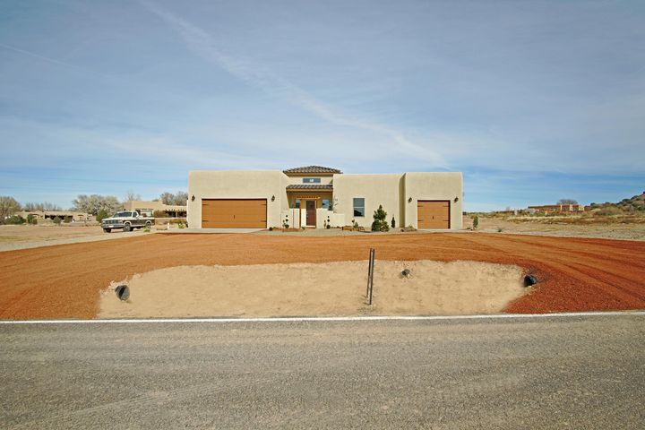 OPEN HOUSE SUN 7/21 1:00-5::00 !NEW CONSTRUCTION ONLY $438K. JUST 1 EXIT PAST RR/PLACITAS- NO TRAFFIC! QUIET  ''TERRA COMMUNITY.'' INSPECTIONS DONE! CUSTOM 1 STORY: 4 BD, 3.5 BA.  NEAR SHOPS & RESTAURANTS! ATTACHED IN LAW QUARTERS W/EXTRA GARAGE, BA, & KITCHENETTE!  COURTYARDS, GRAND ENTRY, HIGH CEILINGS, OPEN GREAT ROOM/KITCHEN/DINING.  NO CARPET!  WOOD BEAMS ON CEILING, MANTLE & DOORS, STACKED STONE FP,  HIGH END KITCHEN: SOFT CLOSE MOCHA CABINETS W/ GRANITE COUNTERS!  LARGE GRANITE ISLAND, SS APPLIANCES: FRIG, GAS RANGE & HOOD, 2 FULL OVENS!!  MASTER SPA BA: HIS & HERS GRANITE VANITIES & 2 WALK-IN CLOSETS, JETTED TUB, HUGE TILED SHOWER!! COVERED PATIO: BEAMED CEILINGS, GAS STUB.  GAS, ELECTRIC, WATER WELL. WALLED FRONT & BACK. 11 MIN TO ABQ. 30 MIN TO SANTA FE. AGENTS CHECK LOSO!
