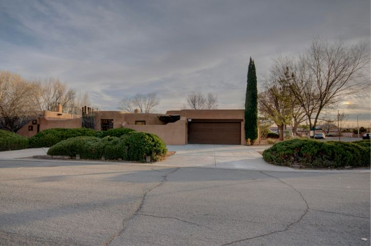 Discover this fabulous North Valley Home-Southwest/Contemporary. Remodeled Kitchen features sleek knotty alder cabinets, granite countertops & breakfast bar, stainless steel appliances & refrigerator. Kitchen opens to great room, dining room, and open patio...an Entertainer's Delight! Great room boasts adobe accent walls. kiva fireplace, brick floors, rough sawn beams & tongue and groove. Wall of windows with loads of light and views of beautiful backyard. 4 bdrms & remodeled, bathroom. Large master suite with cozy kiva fireplace, remodeled bathroom & its own refrig air/heater unit . Newer Roof, New Refrigerated Air, New stucco. Corner lot with lovely trees & florals, fruit bushes, and trees. Walk to the Bosque. Close to freeways and shopping. Desirable North Valley area and Fabulous Home