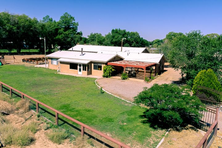 Welcome to north valley living in the village of Los Ranchos De Albuquerque. This recently updated horse property situated on an acre lot features a completely finished guest house, 3 car garage, steel pipe fencing, and private gate for access. This property is a must see!