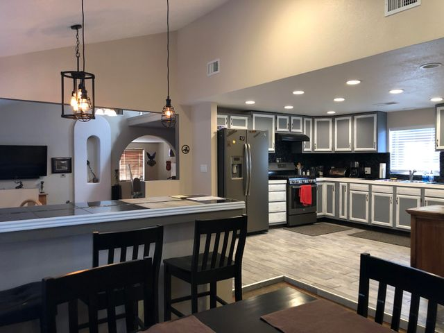 Come see this Diamond in the Rough. Fully Remodeled with custom features. New Flooring, appliances, paint, septic, etc.  Refrigerated AC, 50 Gallon Water Heater, Wood Burning stove in front room and Gas Fireplace in family /game room.  Living area has a step down with raised ceiling.  Master suite has a large master with walk in shower and double sinks and walk in closet.  Property comes with a 30X30 Shop with 30 amp for an RV plug in and 220amp.  Home comes with Pro Panel Roof, and gutters.  Also has 2 car ports(1 is 24X30) to park the toys.  There is horse/animal area which is cross fenced.  Perfect for someone that wants a move in ready home.