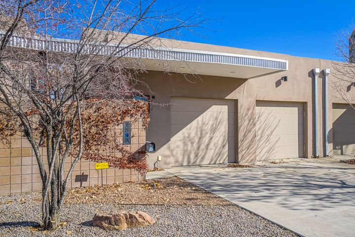 Contemporary Luxury Townhome in the Albuquerque Country Club Area. Tons of features including, Soaring first level ceiling heights, Skylights, Custom Kitchen Pantry and Wine Rack, 1st Level Storage Room, 1st Level Master with Custom Built In Display Shelving, Newly Painted, New Carpeting, 2 Upper Level Bedroom Decks, 1 with Downtown Views, Upper level Office and Possible 4th Bedroom,