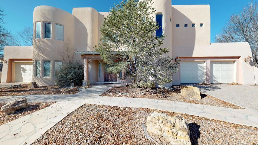 Come take a look!  Enjoy the peace and tranquility of a gated neighborhood in the heart of North Valley close to Nature Center and I-40. Custom home features gorgeous living room with soaring ceilings, beams, vigas, beautiful flooring. gourmet kitchen with wood floors, granite countertops. Downstairs room can serve as a master, in-law quarters or a media/family/gameroom. Bedrooms with gracious balconies. Very pleasant outdoor spaces. Beautiful features throughout.  Home needs some work however priced excellent! Come take a look!
