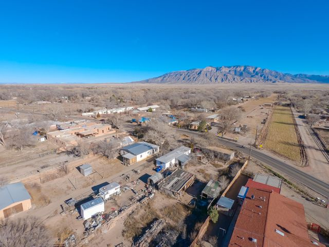 Rare opportunity to own almost an acre of land right on Corrales Road! Property comes with Irrigation Rights and a New Well. Ready for a new owner.