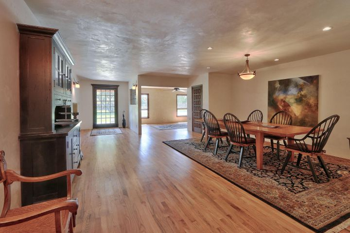 A RARE 3-acre gated estate in the prestigious Los Poblanos Estates subdivision.  So hard to find 3 acres in Los Ranchos at this price!  Chef's kitchen includes wolf and sub-zero appliances.  Cosmetically elegant hardwood and travertine floors, granite counter tops, and diamond finish plaster walls. Spacious bedrooms and living rooms, and enough garage space for 7 cars and workshop!  Newer stucco and wood thermal windows.  Spacious estate includes separate irrigation well for a lush green summer, no water bill!  Very short distance to the Bosque and Los Poblanos farm.  This property is located on one of the most expensive streets in Albuquerque, surrounded by million dollar estates!  Do a drive-by!  This is an AMAZING OPPORTUNITY!