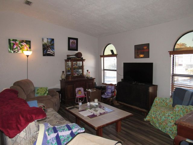 Great opportunity. Property sold ''AS IS''. The panoramic mountain and city views are worth the price alone. Balloon fiesta and 4th of July fireworks are to behold from the backyard patio. Rarely find a 2-car garage and unparalleled views. No polybutylene piping. Even though it is a little rough around the edges, there are many pluses about this home.