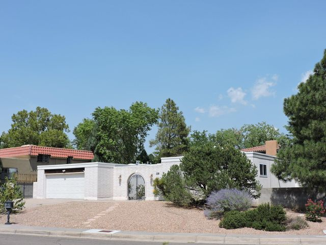 Come visit this wonderful one owner Mossman, Seville model.  Open floorplan, newly installed carpet and fresh paint in bedrooms.  Granite counter tops and a cozy fireplace.  Two refrigerated air large capacity units.  Paved RV Pad with side access.  Covered patio.  Home is on a corner lot of a cul de sac.  Nearby to golf course, Albuquerque Academy, and shopping areas. Priced ready to sell!   This home is a gem, offer now!