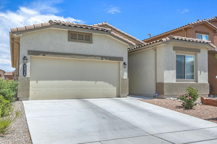 Fabulous almost new DR Horton one year old home with all the upgrades you have been looking for. Chefs delight kitchen with huge island, granite counters, pantry and stainless steel appliances including refrigerator. Owner's suite is separate from the other two bedrooms and includes a large bathroom with double sink, shower and tub separate and walk-in closet. Grab this Certified Green Built home that ready for all your dreams to be made in this lovely home. Excellent area with jogging paths, easy access to Paseo Del Norte, Rust hospital, just a jont from Downtown.  Buy this home today before the interest rates get over 5% !!!! Hurry, Hurry!