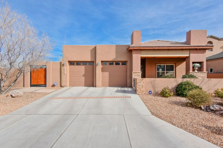 Beautiful Paul Allen Green build located in the gated Rincones de Los Ranchos community of North Valley! Home features 2,209sf with 3 bedrooms, 2 full bathrooms and 2 living areas! Open the door and feel the elegance of this home with the extensive stone and tile work.  Spaciously designed kitchen with upgraded espresso cabinetry,  solid countertops, custom backspalsh, stainless steel appliances, pantry and a breakfast nook.  Main living area w/ porcelain wood look tile and a gas fireplace! Grand master suite with spa-like bath! Bath hosts  dual sinks, an over-sized vanity, garden tub for relaxing and a walk-in shower! State of the art Taexx Pest Control System built into the walls!  Outside enjoy the day under the extended Pergola!  Green construction keeps energy and water costs low.