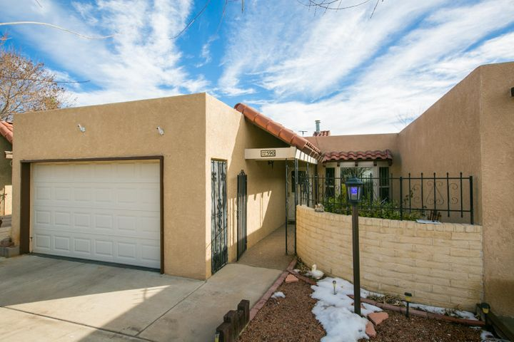 Move In Ready, Charming Two bedroom, Plus an office, one and 3/4 Bath, oversized garage Town Home.  Views of the Sandias from your easy care back yard. Large great room with Beamed Ceilings. Formal Dining room .  Eat in Kitchen,  and ample cabinets in the kitchen. All Appliances Stay.  Freshly painted and Ready for New Owners. . A great Place to call Home.