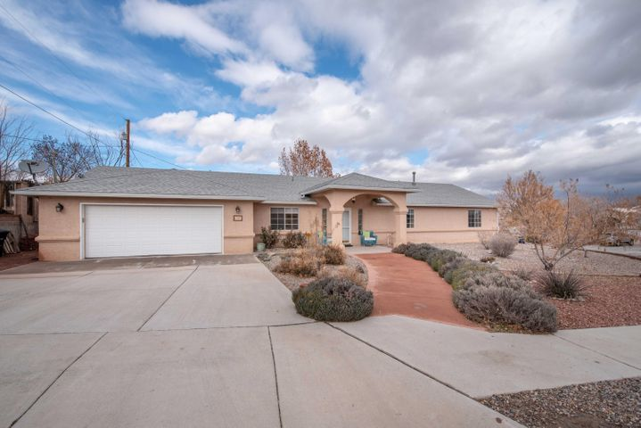 Wonderfully updated home with a spacious and open floorplan.  Beautiful engineered Acacia hardwood floors greet you when you enter and make the home feel warm and comfortable. Soaring ceilings add to the open feeling. The cozy 3-way gas log fireplace is sure to please on those cold winter nights. The master bathroom features a raised double vanity with granite counter top & wait until you see the updated spa-like shower! In the kitchen, the sellers have replace the gas oven/range and microwave and the S/S refrigerator stays! Check out the bonus room that would make a great office, exercise room, or bedroom! The landscape is easy to care and features 2 apple and 1 pomegranate tree in back. Extra storage available with the large shed. Roomy garage and  Refrigerated AC. This home is a 10