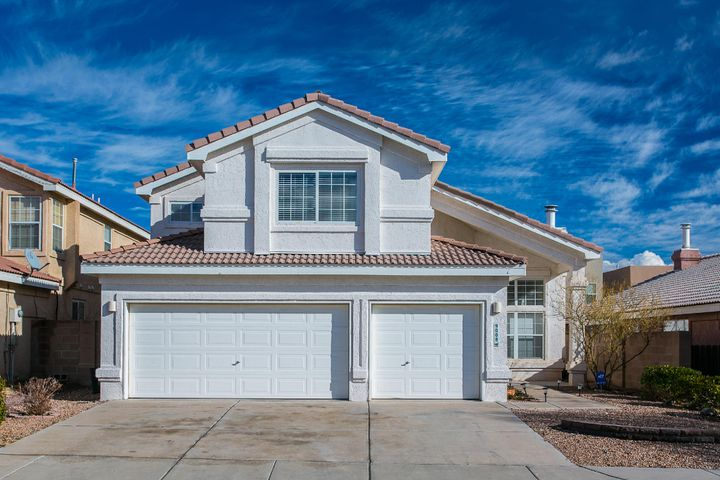 BEAUTIFUL two-level home in well-established Northwest community.  Bright, open floorplan with tons of room for everyone.  Perfect family home with five bedrooms.  Walk the kids 750 ft. from your front door to Petroglyph Elementary's entrance.  Wonderful neighborhood with convenient access to shopping, restaurants, and main arterial roads.  Granite countertops, upgraded sinks and faucets, newer appliances.  You will not be disappointed in this home.
