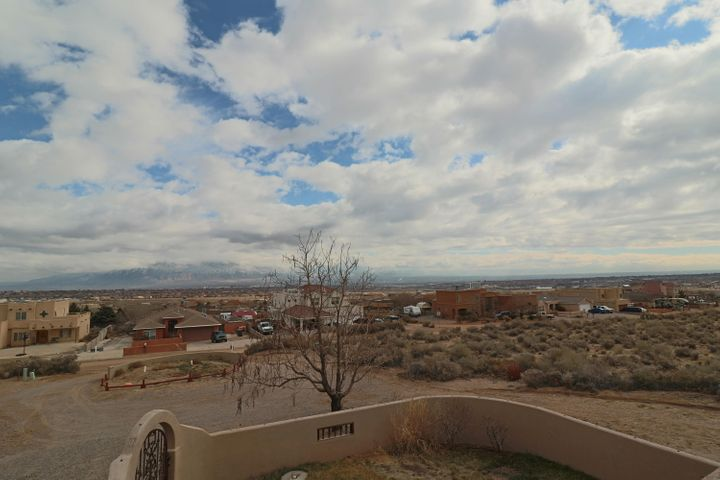 This gorgeous home sits on a half acre lot with amazing views of the Sandia Mountains. Your next home has 5 bedrooms and an amazing kitchen with granite countertops and stainless steel appliances. This home has everything you're looking for in a custom home with no HOA.