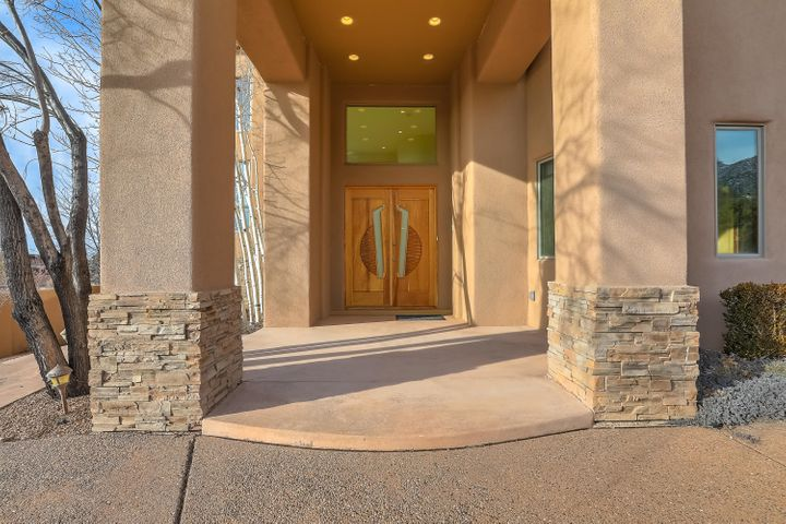 Life in harmony...enjoy proximity to all the city life that Albuquerque has to offer and then escape to the peaceful Sandia Foothills. This luxury home will be your private oasis, replete with panoramic views.  Enjoy the gourmet kitchen, multiple indoor and outdoor living spaces, and 5 spacious bedrooms. Entertain elegantly on a grand or intimate scale.  Media room, guest suite with separate entrance, and thoughtful design elements throughout the home, such as ''His and Hers'' walk-in closets, will make this home a dream come true for the discerning buyer. Please allow 48 hour response time on all offers.  Seller prefers Lisa Ortega at Old Republic Title.